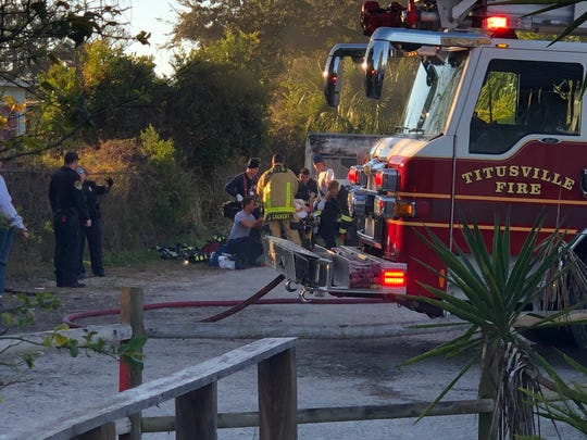 Titusville Fire Department crews responded to a house fire that left one woman severely injured