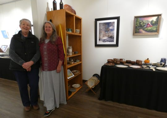The Crawford County Arts Council's program coordinator, Peg Wells, left, and president, Beverly Morgan, stand in the gallery at the council's building on East Mansfield Street. The council is seeking to get more people to visit their building, where local artists' work is displayed.