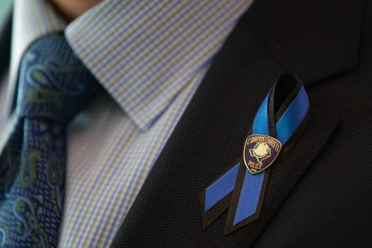 Corpus Christi City Manager Peter Zanoni wears a ribbon to honor fallen Officer Alan McCollum during a press conference on Monday, Feb. 3, 2020.
