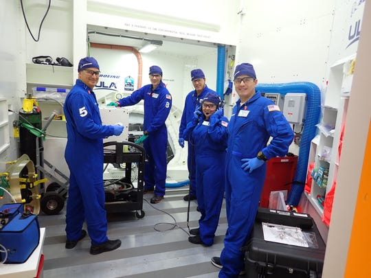 Melanie Weber and other members of the pad team perform closeout crew operations ahead of the Starliner's orbital flight test.