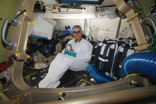 Aerospace engineer Melanie Weber, a Corpus Christi native, sits in the Boeing Starliner spacecraft before its orbital flight test. Weber helped design the interior of the spacecraft.
