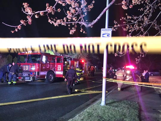 Police and firefighters respond to the scene of a house fire on Medley Lane in Willingboro on Sunday night.