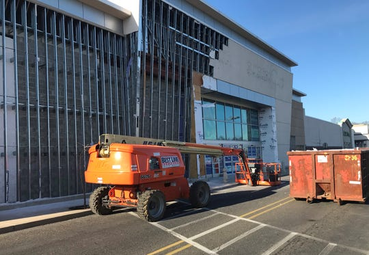 Workers are preparing a former Toys R Us in Cherry Hill to hold two new tenants