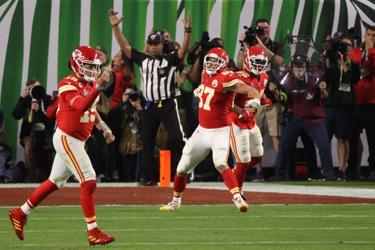 Feb 2, 2020; Miami Gardens, Florida, USA; Kansas City Chiefs tight end Travis Kelce (87) celebrates after scoring a touchdown in the fourth quarter against the San Francisco 49ers in Super Bowl LIV at Hard Rock Stadium.