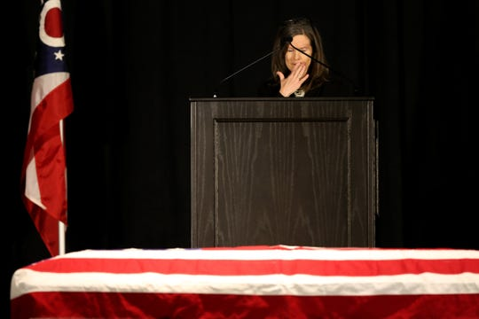 Hamilton County Commissioner Denise Driehaus delivers remarks during the funeral of Hamilton County Commissioner Todd Portune, Monday, Feb. 3, 2020, at the Duke Energy Convention Center in Cincinnati. Portune died Jan, 25, 2020, at his home in Green Township.