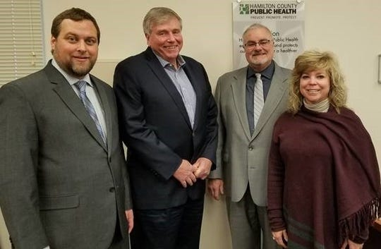 Tim Ingram, Hamilton County's health commissioner for 27 years, announces his retirement Feb. 3. At left is his interim successor, assistant commissioner Greg Kesterman. At right are Jim Brett, chairman of the county board of health, and board member Tracey Puthoff.