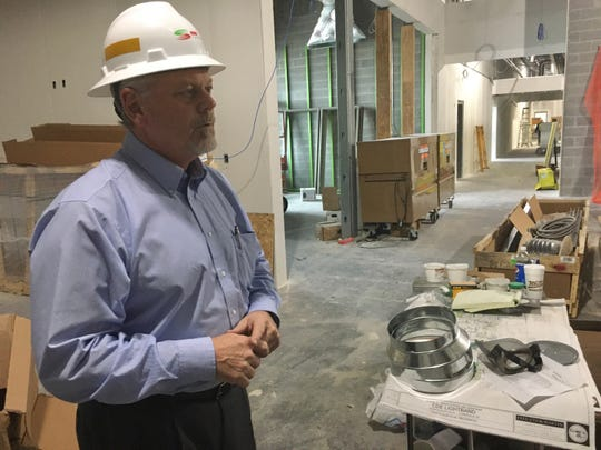 On a tour of the construction zone that is to become the Clarksville Department of Electricity's expanded office space, General Manager Brian Taylor discusses how it will benefit customers.