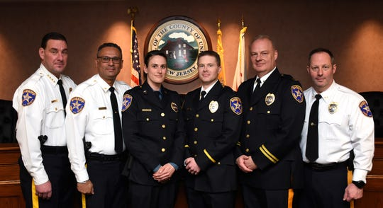 Union County Sheriff Peter Corvelli joined Undersheriffs Dennis Burke and Amilcar Colon in congratulating newly promoted Sheriff's Captain Frank Miller, Lieutenant Patrick Hyland and Sergeant Ashley Yasinski during a ceremony in Elizabeth.
