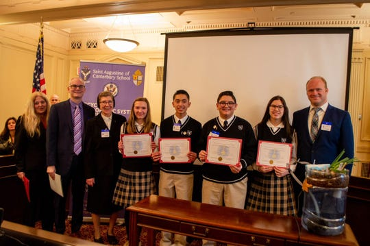 St. Augustine of Canterbury School students are recognized at the Statehouse on Jan. 27 for their recycled hydroponic system STEM project.