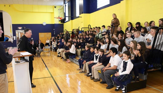 Bishop James F. Checchio visits with St. James School students on Jan. 29 to celebrate Catholic Schools Week.