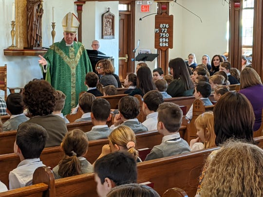 Bishop James F. Checchio celebrates Mass on Jan. 29 at The School of St. Elizabeth at Our Lady of Perpetual Help Church in honor of Catholic Schools Week.