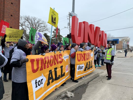 Demonstrators from the Fight for 15 movement gathered outside the corner of Forest Avenue and 27th Street in Des Moines, Iowa, on Monday, Feb. 3, 2020, to demand a $15 an hour minimum wage and union rights.