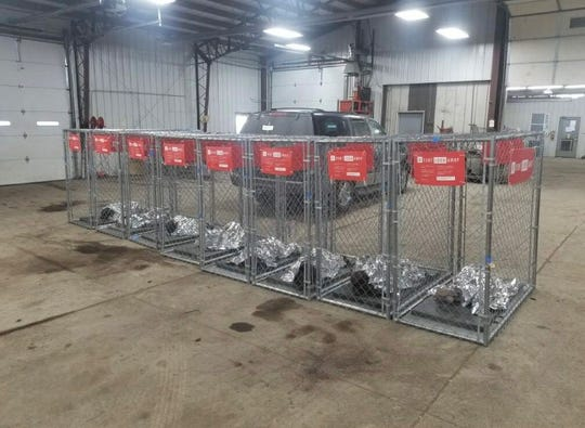 Des Moines police say these cages, each containing a doll and speaker system, were placed on sidewalks and in a park in an apparent attempt at political expression early on Caucus Day.