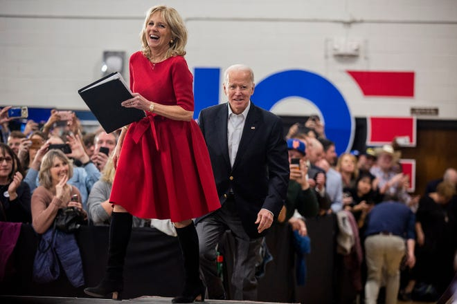 Former Vice President Joe Biden and his wife Jill Biden take the stage before speaking to the crowd of people gathered in the Hiatt Middle School Gymnasium on Sunday, Feb. 2, 2020, during Biden's last rally in Des Moines before the caucuses.