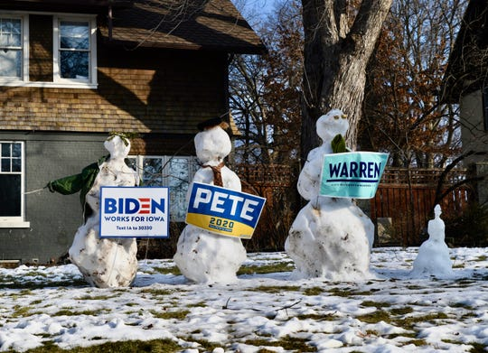 Snowmen dressed as Democratic presidential candidates former Vice President Joe Biden, left, former South Bend, Indiana Mayor Pete Buttigieg and U.S. Sen. Elizabeth Warren of Massachusetts stand guard in one Des Moines yard on Caucus Day, February 3, 2020.