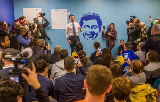 Pete Buttigieg speaks to volunteers during a Caucus Day visit to his West Des Moines field office.