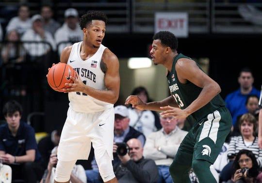 Penn State forward Lamar Stevens holds the ball as Michigan State forward Xavier Tillman defends at Bryce Jordan Center, Jan. 13, 2019.