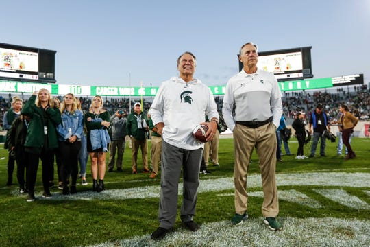 Sept. 28, 2019: Michigan State 40, Indiana 31, Spartan Stadium: Mark Dantonio watches a video on the scoreboard next to basketball coach Tom Izzo to celebrate his program record for wins. The record was set the week prior on the road.