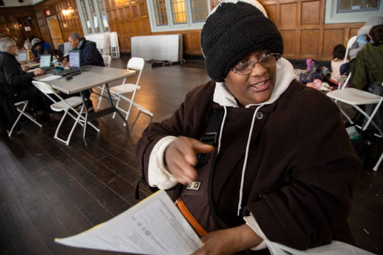 Crystal Johnson, 53, of Detroit took two buses to have her taxes done at the Durfee Innovation Society in Detroit Friday, Jan. 31, 2020.