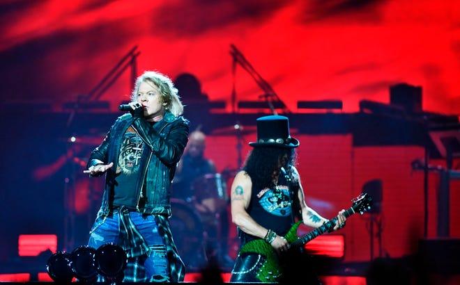 Axl Rose (left) and Slash perform at the Friends Arena in Stockholm, Sweden, on June 29, 2017.