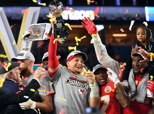 Kansas City Chiefs quarterback Patrick Mahomes hoists the Vince Lombardi Trophy after defeating the San Francisco 49ers in Super Bowl LIV at Hard Rock Stadium in Miami Gardens, Feb. 2, 2020.