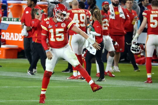 Chiefs quarterback Patrick Mahomes celebrates after a touchdown in the fourth quarter against the 49ers in Super Bowl LIV at Hard Rock Stadium in Miami on Sunday.