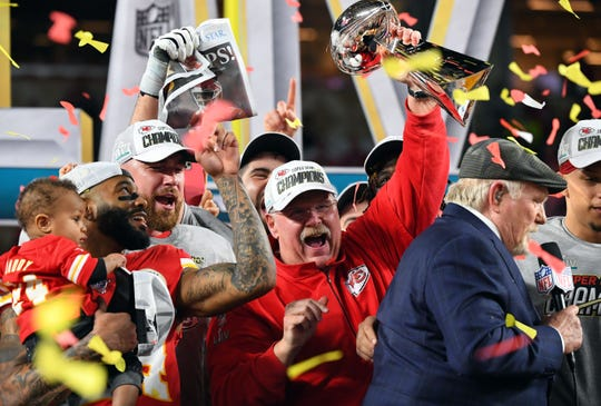 Kansas City Chiefs coach Andy Reid hoists the Vince Lombardi Trophy after defeating the San Francisco 49ers in Super Bowl LIV at Hard Rock Stadium in Miami Gardens, Feb. 2, 2020.