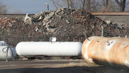 Looking through the lot of Motor City Propane at debris pilled on the property of Smalley Construction on Sunday, February 2, 2020 in Detroit, Mich.