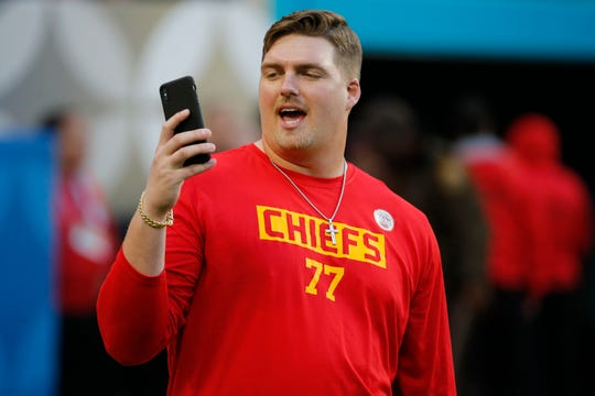 The Kansas City Chiefs' Andrew Wylie speaks on a phone before the Super Bowl on Sunday night.