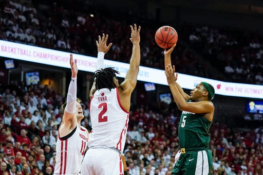Michigan State's Cassius Winston puts up a shot during Saturday's loss to Wisconsin.