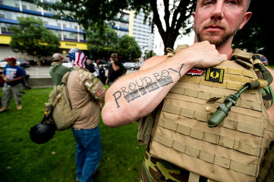 """Joseph Oakman, a member of the Proud Boys, wears body armor during an """"End Domestic Terrorism"""" rally in Portland, Ore., on Saturday, Aug. 17, 2019.   (FILE)"""
