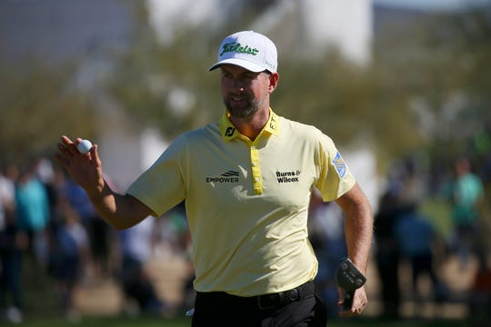 Webb Simpson waves to the gallery after making birdie on the 10th hole during the final round of the Waste Management Phoenix Open PGA Tour  Sunday in Scottsdale, Ariz.