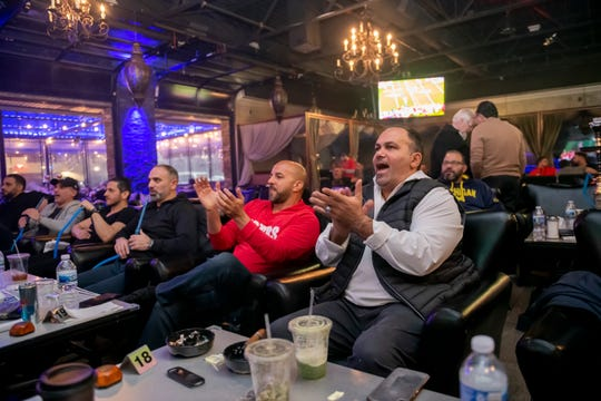 Friends of Dearborn native and San Francisco 49ers defensive coordinator Robert Saleh cheer while watching the Super Bowl at the Lava Lounge Too, in Dearborn Heights, February 2, 2020.