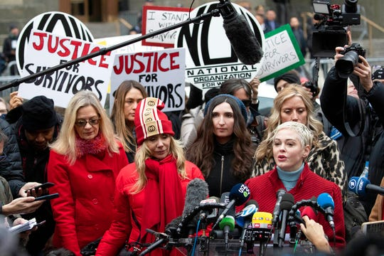 Actor Rose McGowan, right, speaks at a news conference as actor Rosanna Arquette, center left, listens outside a Manhattan courthouse after the arrival of Harvey Weinstein, Monday, Jan. 6, 2020, in New York.