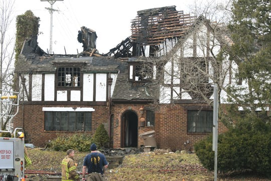 Firefighters asses the damage to a historic home at 148 Ottawa at the corner of Menominee, in Pontiac on Feb. 3, 2020.