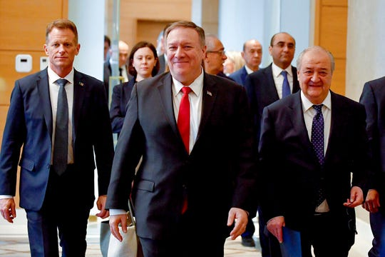 U.S. Secretary of State Mike Pompeo, center, and Uzbekistan's Foreign Minister Abdulaziz Kamilov, right, arrive to attend a joint news conference following the talks in Tashkent, Uzbekistan, Monday, Feb. 3, 2020.