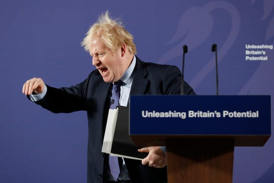 British Prime Minister Boris Johnson outlines his government's negotiating stance with the European Union after Brexit, during a key speech at the Old Naval College in Greenwich, London, Monday, Feb. 3, 2020.