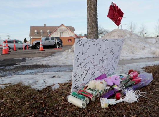 A makeshift memorial is seen on Sunday outside Gene's Supper Club, 4323 N. 60th St. near the scene where a pregnant woman died early Saturday following a drive-by shooting. (Mike De Sisti/Milwaukee Journal Sentinel via AP)