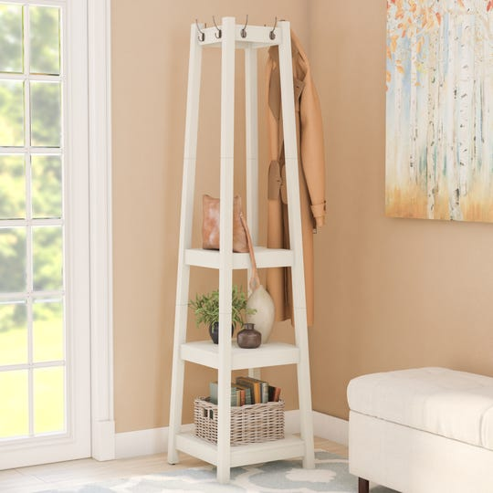 A variety of sizes and shapes makes your spaces come alive like this pyramid coatrack that draws the eye up.