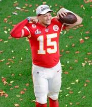 Kansas City Chiefs quarterback Patrick Mahomes (15) celebrates after winning Super Bowl LIV