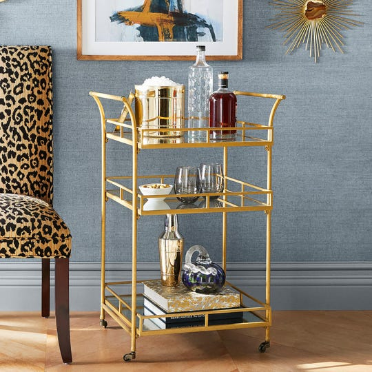 This Golden Square Bar Cart from Pier 1 Imports priced at $229.99 makes your favorite snacks and beverages look like winners.