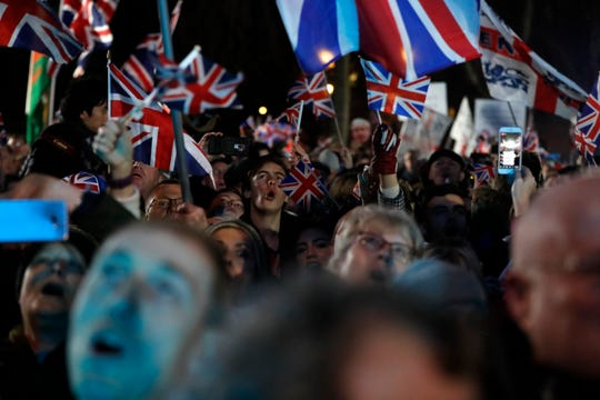 Brexit supporters celebrate during a rally in London, Friday, Jan. 31, 2020. Britain leaves the European Union after 47 years, leaping into an unknown future in historic blow to the bloc.