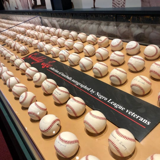 Autographed baseballs donated by Geddy Lee of the rock band, Rush.