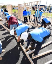 Volunteers work on interior walls as they join Central Delaware Habitat for Humanity for a 'Framing Frenzy' event in Dover, Del., in this Oct. 24, 2019, file photo. Spending on construction projects edged down 0.2% in Dec., ending a year when total construction registered its first annual decline in eight years.