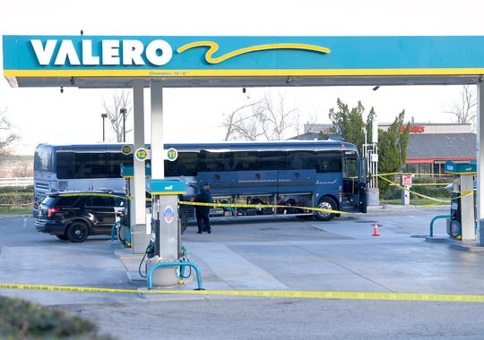 Investigators are seen outside of a Greyhound bus after a passenger was killed on board on Monday, Feb. 3, 2020 in Lebec, Calif. A gunman killed one passenger and wounded multiple others on a Greyhound bus traveling from Los Angeles to the San Francisco Bay Area early Monday morning, the California Highway Patrol said.