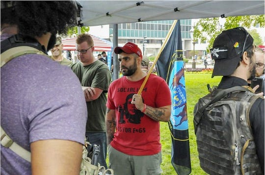 """During a Second Amendment rally in Lansing in September, Morgan Bolles wears a T-shirt with the picture of a limp-wristed Che Guevara, the Marxist revolutionary, that reads """"Socialism is for f-gs,"""" with the last word missing a letter."""