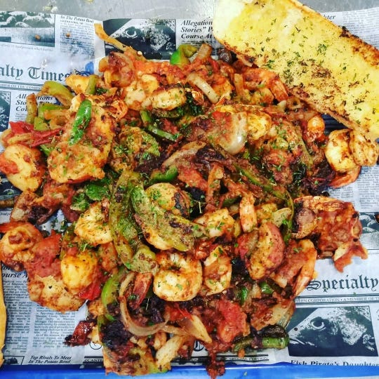 A half-sized California Shrimp Tray at Catfish Willy's Seafood and Crab Shack. Eat one in 20 minutes and you'll get a free t-shirt and a $5 gift certificate towards your next visit.