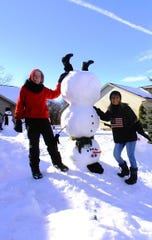 Linda and Dennis Hemauer's gravity-defying upside-down snowman appeared in early February, adding to the party of snow people -- and one snow dog -- already living in the Hemauer's yard.