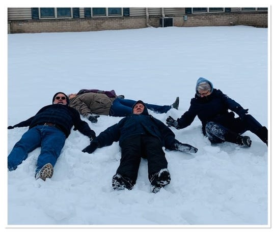 Barb Drollinger, in back, and Gary Scheer, Gene Scheer and Annette Erickson made snow angels in late January.