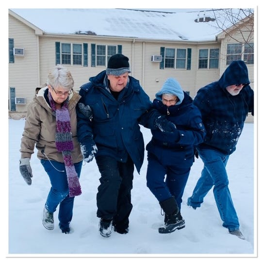 Gene Scheer, second from left, made his first snow angel at 90 years old. He was assisted by his daughters Barb Drollinger, at left, Annette Erickson, at right, and son Gary Scheer, at far right.